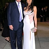 Melania wore a lacy, white bustier-style dress with a thigh-high slit to the 2004 Vanity Fair Oscars party.