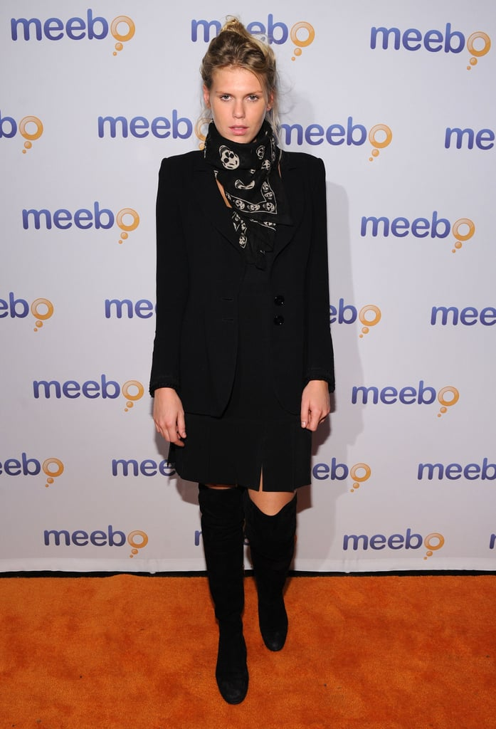Alexandra Richards matched her mood with her dark ensemble. The over-the-knee boots are spot-on, as is her Alexander McQueen skull scarf.