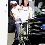 Sandra Bullock and Louis Bardo both wore hats.