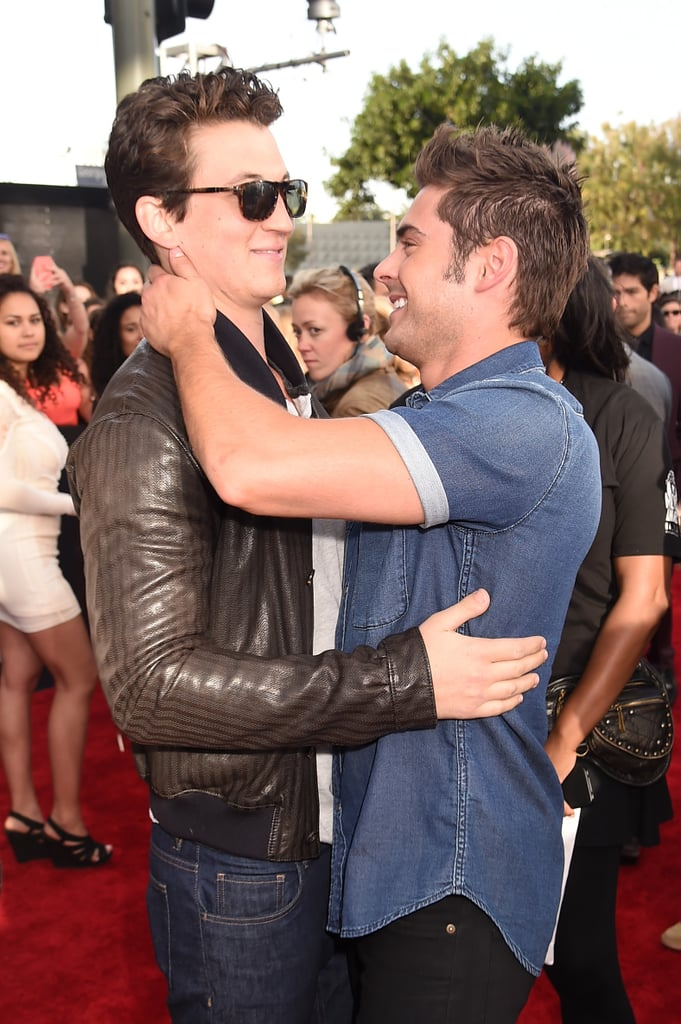 Zac Efron and Miles Teller hugged it out on the carpet.