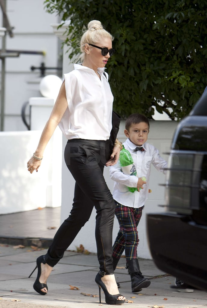 Gwen Stefani ran errands with Kingston by her side in London today. It's Gwen's 42nd birthday and the No Doubt frontwoman, who was accompanied by her son and a friend, flashed a smile as she made her way back to their flat. Later, an oversized delivery of flowers was dropped off at the house. The lavish bouquet may have been from her husband, Gavin Rossdale, who unfortunately couldn't be with Gwen to mark the special occasion. He's been busy touring with his band, Bush, and the quartet is playing a show in Saint Paul, MN, tonight. Gwen, Kingston, Gavin, and Zuma Rossdale have been spending time at their place in England lately, with plenty of trips back and forth to LA, where Gwen has been working on No Doubt's reunion album. The Stefani-Rossdales recently met up with another American family in England, the Jolie-Pitts. Angelina Jolie and Gwen's kids had a playdate last week, during which the little ones got messy playing with paint.
