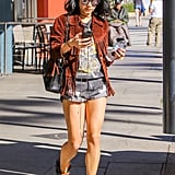 Giving cutoffs a rocker twist, Vanessa Hudgens opted for a fringed jacket, a vintage tee, and ankle boots.