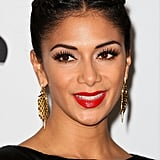 At the Music Industry Trusts' Awards in London in November 2012, fluttery lashes and a bold red lipstick made sure Nicole kept all the attention despite that trademark hair being centre-parted and tightly plaited off the face.