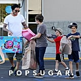 David Beckham and his boys went toy shopping for Harper in LA in March 2012.