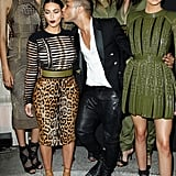 Kim Kardashian got a kiss from Balmain designer Olivier Rousteing as she and sister Kendall Jenner attended the Vogue Foundation Gala in Paris on Wednesday.