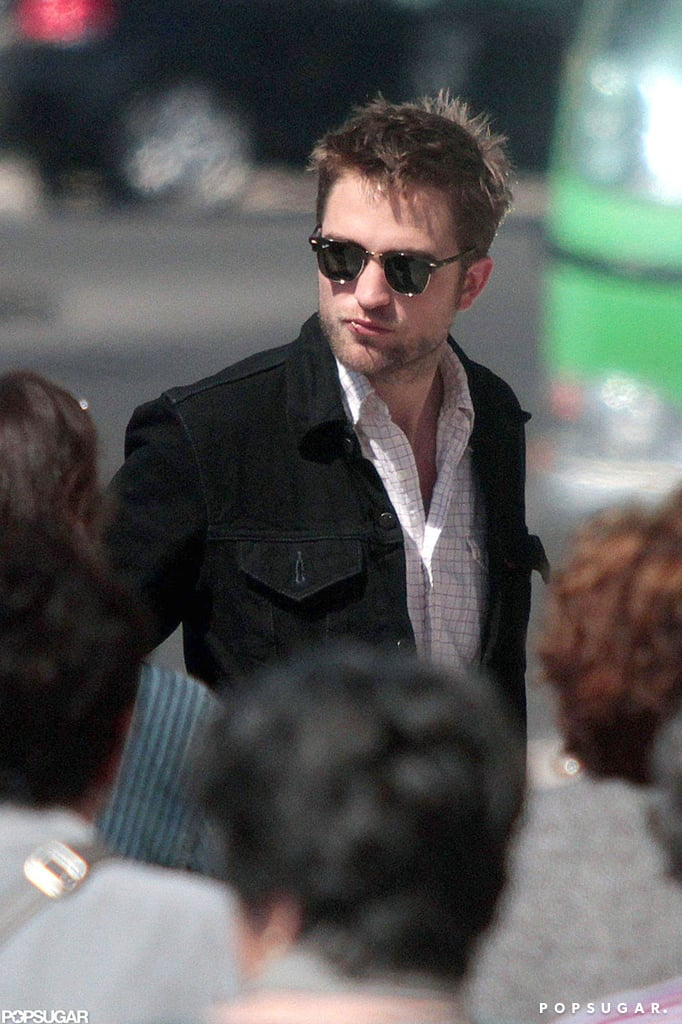 Robert Pattinson popped up in Lisbon today with his parents, Richard and Clare. Rob was last in Cannes hanging out with girlfriend, Kristen Stewart, and promoting his upcoming release, Cosmopolis. His David Cronenberg-directed film got mixed reviews, but despite the mediocre critiques, Rob appeared to enjoy his time in France. Right before jetting to Portugal, Rob was spotted laughing and dining with friends and fellow Hollywood hunk Matthew McConaughey. Kristen couldn't continue onto Lisbon to sightsee with Rob, as she's already back in LA making a final promotional push prior to Friday's release of Snow White and the Huntsman.