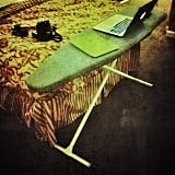 If your hotel room doesn't have a desk, use the ironing board.