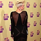 Miley Cyrus showed off the back of her black gown on the red carpet.