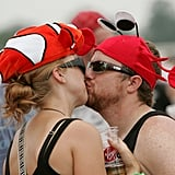 A couple kissed in fish hats at the Virgin Festival in Baltimore, MD.