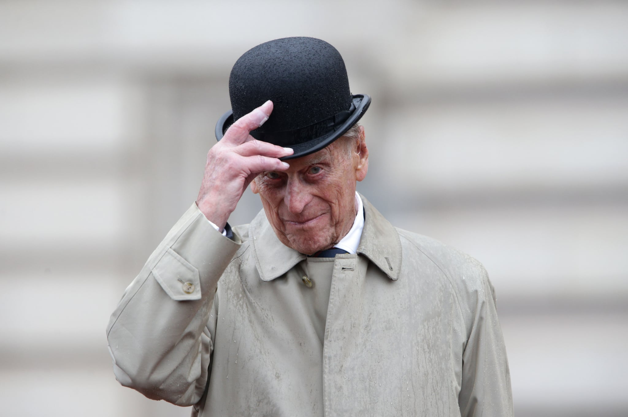 Britain's Prince Philip, Duke of Edinburgh, in his role as Captain General, Royal Marines, attends a Parade to mark the finale of the 1664 Global Challenge on the Buckingham Palace Forecourt in central London on August 2, 2017.  Prince Philip, the 96-year-old husband of Queen Elizabeth II, conducted his final solo public engagement on August 2, 2017, overseeing a military parade in the pouring rain before retiring from a lifetime of service. The Duke of Edinburgh, wearing a raincoat and bowler hat, met members of the Royal Marines and veterans -- many younger than him -- before taking the salute in the forecourt of Buckingham Palace. / AFP PHOTO / POOL / Yui Mok        (Photo credit should read YUI MOK/AFP/Getty Images)