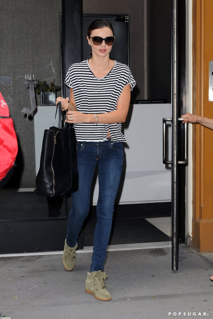 Miranda Kerr wore her olive-green Isabel Marant kicks with a striped tee and dark skinny jeans.
