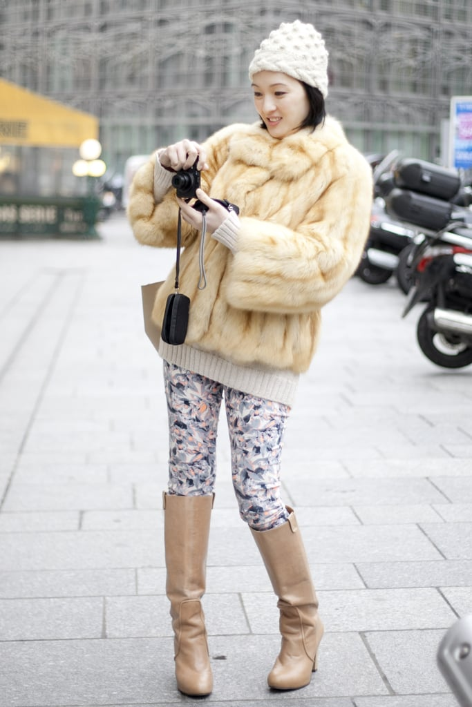 A furry zip-up gave printed pants a glammed-up feel — but we love that she simplified things with boots in the same color palette.