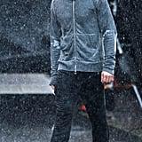 Rain makes us look like wet rats, but it makes Dornan look like a Greek god.