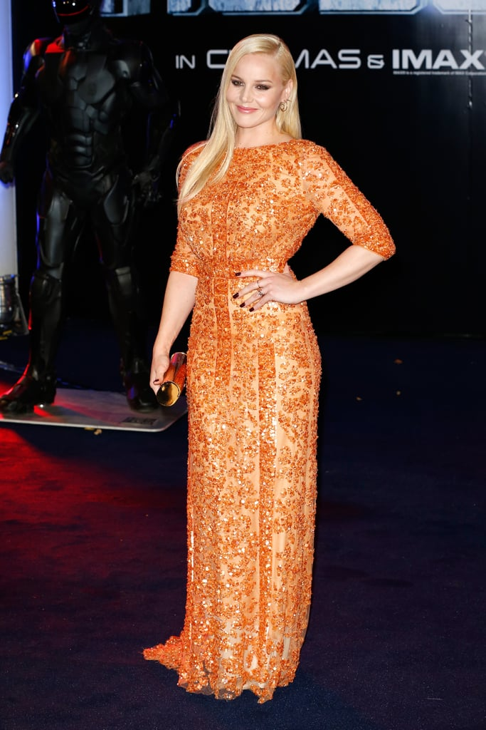 Abbie Cornish has spent the past few months on the promo trail for the RoboCop reboot, and she certainly turned heads at the movie's world premiere in London on Wednesday night. The Australian actress, who stars as Alex Murphy/RoboCop's wife, wore an embellished orange gown on the red carpet and showed off sexy, smoky eyes to complete her vampy look. She was joined by her leading man, Joel Kinnaman, and co-star Gary Oldman at the event, which was also attended by Olivia Munn. Abbie isn't the only member of the Cornish family celebrating good work this week; her younger sister, Isabelle, has landed her first US role in a drama pilot called Sea of Fire. RoboCop is in Australian cinemas now.