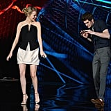 Andrew jokingly checked out Emma on stage at the June 2012 MTV Movie Awards in LA.