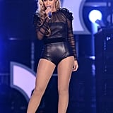 Beyoncé sang to her fans in a black leather and sheer Gucci leotard and lace-up Stuart Weitzman boots.