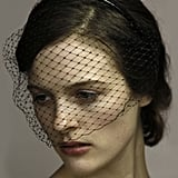 I would totally rock a black veiled face mask for Derby Day — chic but still modern! Race day dressing needs a bit of a shake-up in my opinion, I wish more people experimented with new takes on headwear. — Marisa, publisher Headband, $182, Jennifer Behr