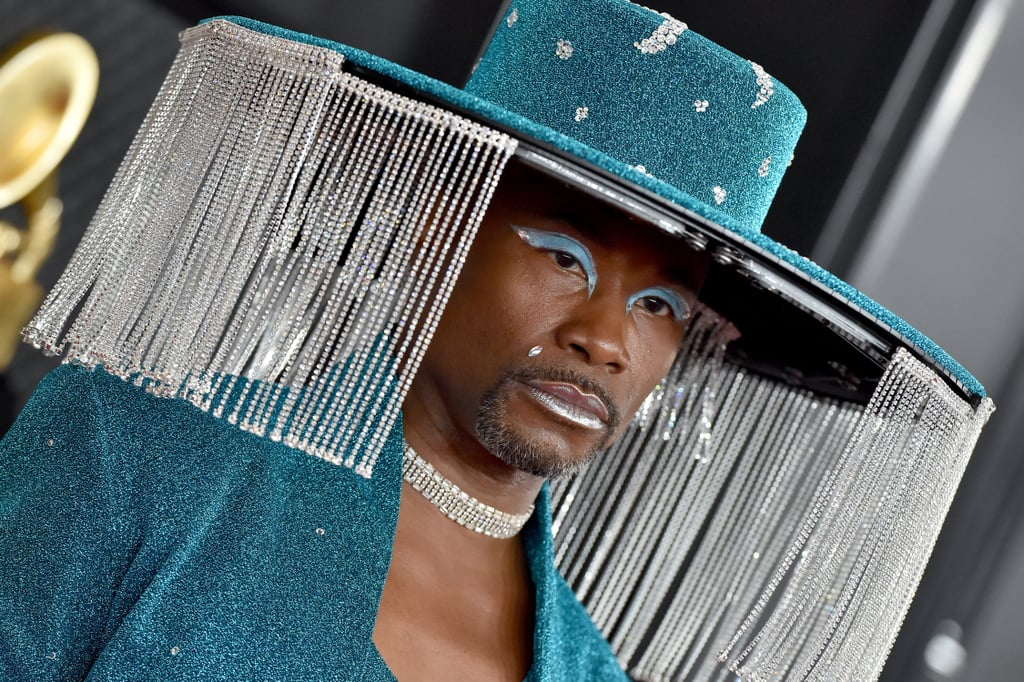 "As the saying goes, great minds think alike — perhaps more so when they share the same name. In a recent virtual appearance on The Tonight Show, Billy Porter revealed that the inspiration behind his meme-ready, mechanical hat at the 2020 Grammys had actually been inspired by Billie Eilish.  ""It came about because when we were at the American Music Awards, I was right behind Billie Eilish on the red carpet, and she was wearing this Gucci veil. It was so cute,"" Billy told Jimmy Fallon. (It's worth noting that Billie's veil that evening was actually by Burberry, but she would later go on to wear a Gucci face mask to the Grammys.) Though Billy loved the look, he was hesitant because, ""I'm never wearing something that covers up my face. I've waited too long for this moment. Folks need to see my face."" ""Somebody's gotta do it."" That's when his stylist, Sam Ratelle, offered a perfect solution: ""What if the veil opened and closed electronically?"" And thus, the retractible fringe hat was born from Sarah Sokol Millinery. Billy added, ""Somebody's gotta do it."" Watch Billy reflect on the memorable red carpet moment ahead, and then browse a few photos of both the look and its original inspiration.      Related:                                                                                                           Billy Porter Asked Fans to Show Off Their Runway Walks, and the Responses Were FIERCE"