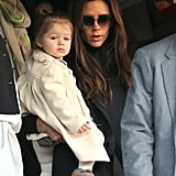 Victoria Beckham held her daughter Harper as they cheered on dad David Beckham during a soccer match in Paris on Saturday.