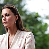 The Duchess wore simple drop earrings with her hair half-up half-down.