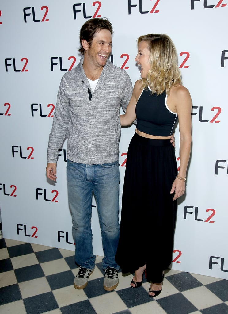 """Kate Hudson had a little help from her older brother, Oliver, at the NYC launch of her new men's athleticwear line, FL2, on Thursday. The siblings posed playfully on the red carpet, cracking each other up in between smiles. The new collection comes after Kate debuted her own Fabletics brand in 2013. Kate and her friends have appeared in ads for the line of women's fitness clothing, and now she has Oliver's help promoting FL2. Kate told WWD he was her """"go-to for style and function feedback"""" and is also a spokesperson for the affordable collection.  It wasn't Kate's first family event this week since she attended the Glamour Women of the Year Awards with her mom, Goldie Hawn, on Tuesday. The mother-daughter duo has had plenty of good times on the red carpet over the years, just one of the many reasons to love the famous family!"""
