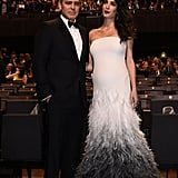 Amal's bump made its red carpet debut in this stunning feathered gown, a custom Versace creation.