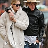 Cody Simpson and Gigi Hadid bundled up and cuddled up on Thursday in NYC.