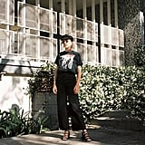 Style Your Favorite Band Tee With Wide Leg Jeans, Strappy Sandals, and a Baker Boy Hat