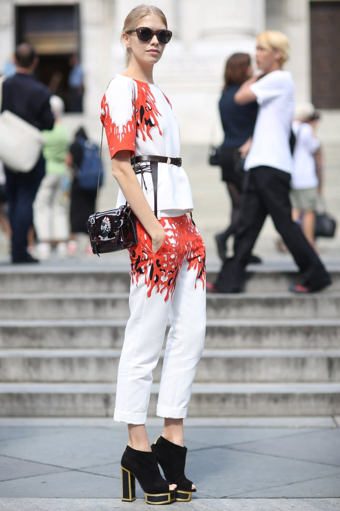 A bold print acted like a frame on this white top-and-trouser set by Tibi. The whole look also got a lift courtesy of some platform open-toe booties. Source: Greg Kessler