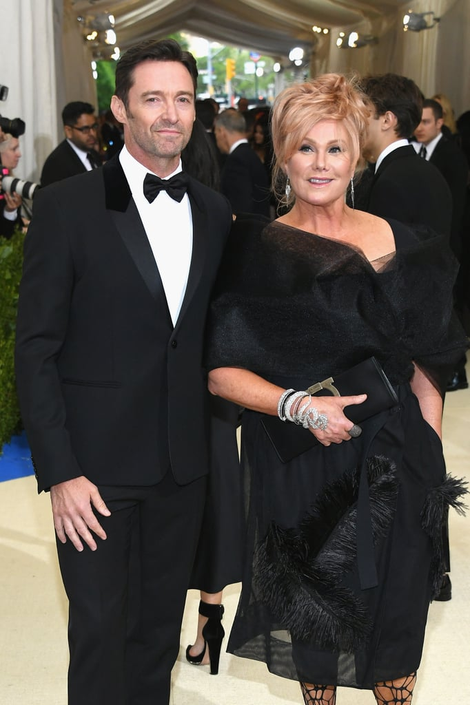 "Hugh Jackman and his wife, Deborra-Lee Furness, are turning the Met Gala into their own personal date night. The couple, who recently celebrated their 21st wedding anniversary, got all dolled up for the event in NYC on Tuesday. ""We're just going out for a walk,"" the Logan actor captioned a photo of the two ahead of the event. While his wife matched her black dress with fishnet stockings, Hugh looked dashing in a tux and bow tie."