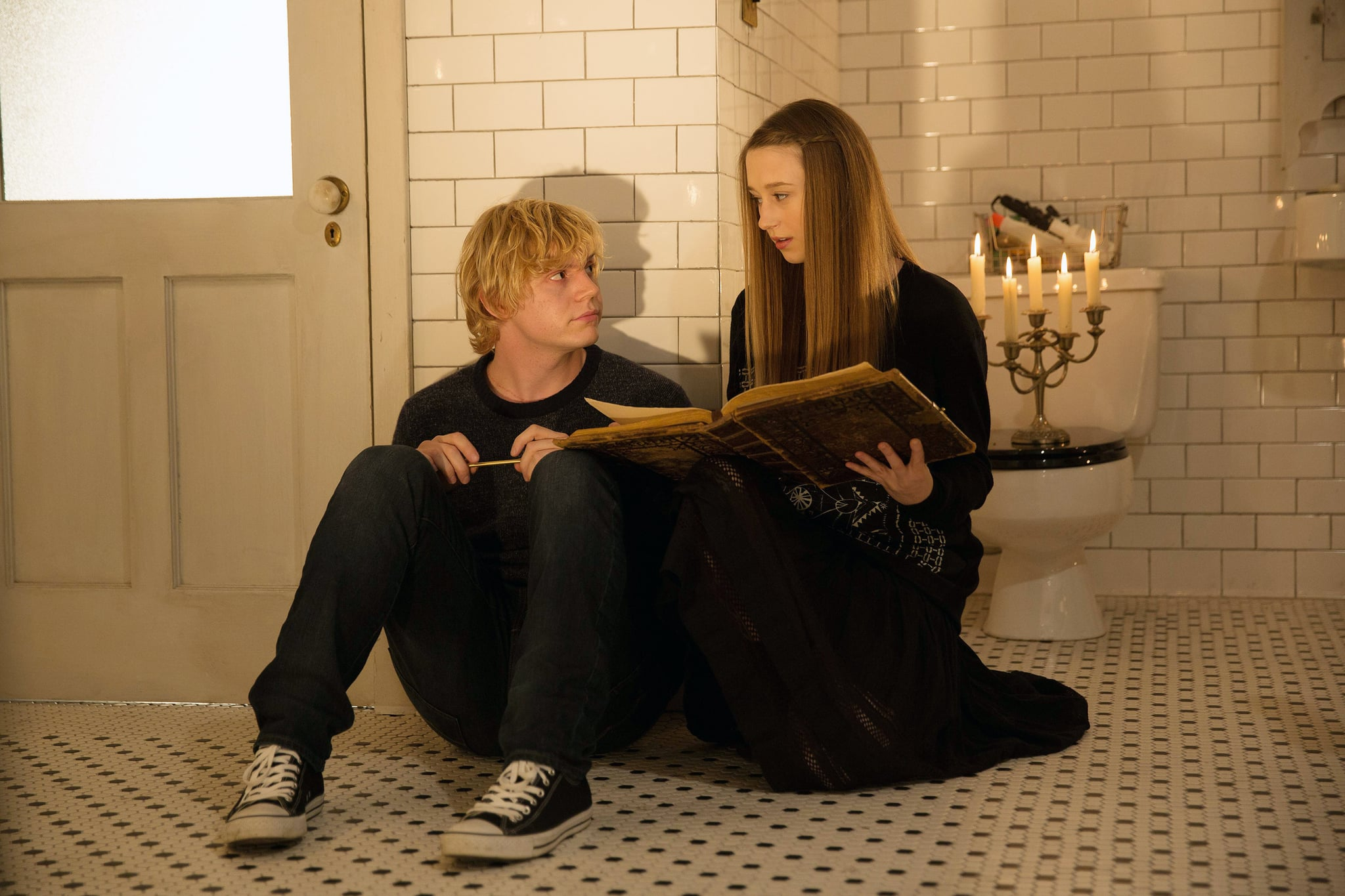 AMERICAN HORROR STORY: COVEN, l-r: Evan Peters, Taissa Farmiga in 'Protect The Coven' (Season 3, Episode 11, aired January 15, 2014). ph: Michele K. Short/FX/courtesy Everett Collection