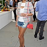 Jamie Chung hung out in Beverly Hills sporting a colorful printed blazer — the same one Sarah Jessica Parker owns — with denim cutoffs, a hot coral mini bag, and gray Matt Bernson booties.