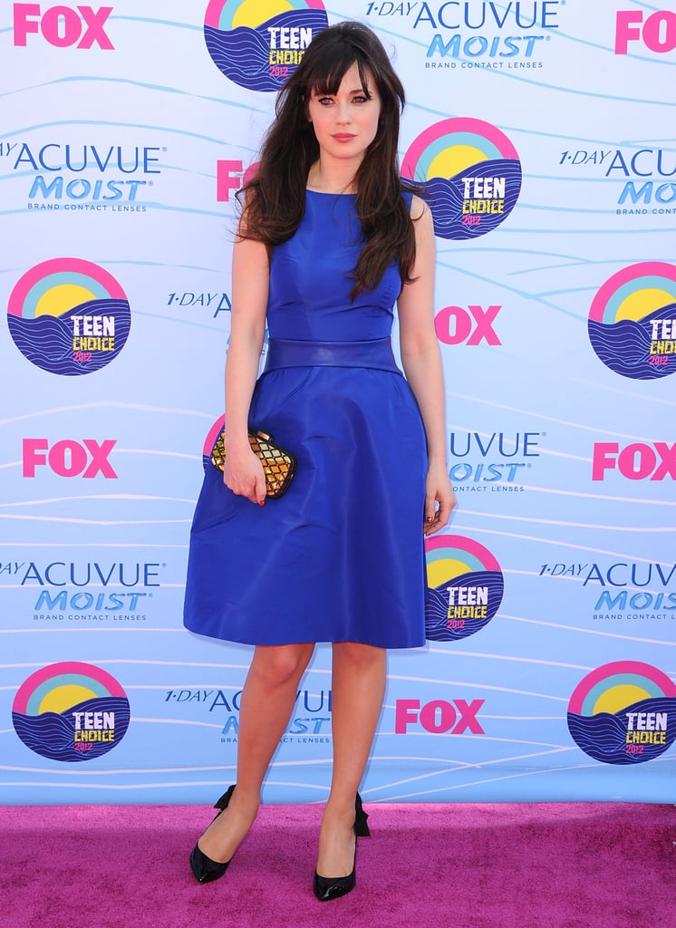 This cobalt-blue Monique Lhuillier fit and flare dress proved a sweet foundation for her bow-tie pumps and gold Jimmy Choo clutch at the 2012 Teen Choice Awards.