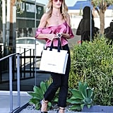 Millennial pink is in and Rosie Huntington-Whiteley wears it perfectly with jeans and heels.