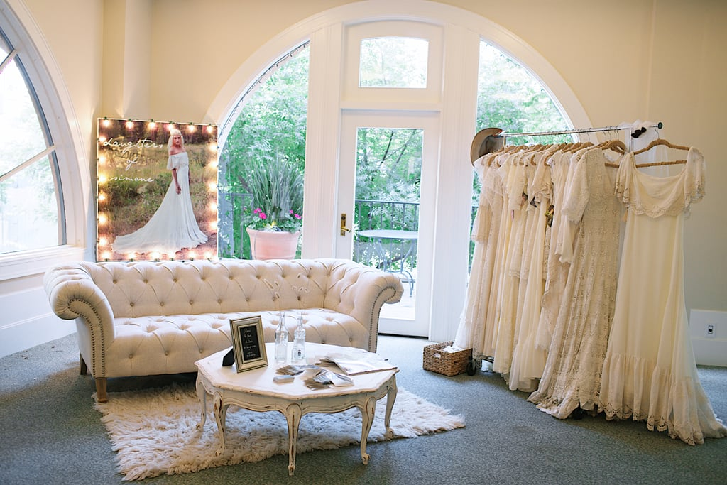 Daughters of Simone had a bridal lounge set up with their vintage, bohemian wedding gowns.  Photo by Ettevy Photography