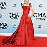 For the 47th annual CMA Awards, Taylor oozed Old Hollywood glamour in an embellished Elie Saab Haute Couture creation featuring a full skirt and mini train. She accessorized her wine-hued gown with nude sandals and dazzling Lorraine Schwartz jewels.