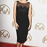 Julia Louis-Dreyfus wore a black dress with a sheer neckline.