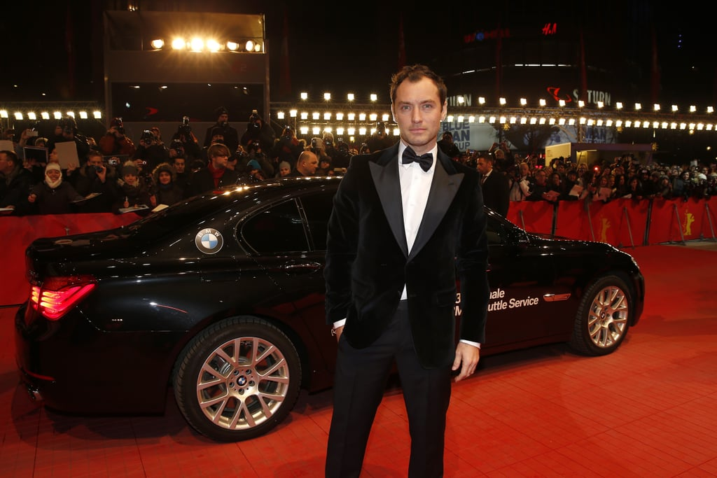 Jude Law posed in front of a BMW on the red carpet Tuesday night in Berlin.