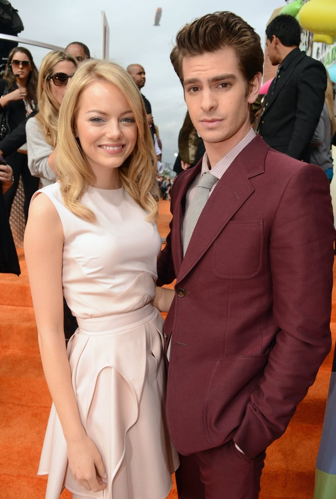 Cute couple Emma Stone and Andrew Garfield posed together on the orange carpet at the Nick Kids' Choice Awards in LA on Saturday. The real-life loves and The Amazing Spider-Man costars looked adorable making their first official red-carpet appearance together. Recently the two have been cozying up in NYC, where Andrew is starring in the Broadway production of Death of a Salesman. Emma cheered him on from the front row at his first performance, and since then she and Andrew have been spotted around Manhattan holding hands and checking out the city. They got all dressed up — she in Antonio Berardi and he in a dapper burgundy suit — for this evening's show, where they both are presenting. Emma also took the chance to catch up with Kristen Stewart on the way in. Check FabSugar for all the Kids' Choice Awards fashion details, and follow PopSugar on Twitter for updates from inside the show.
