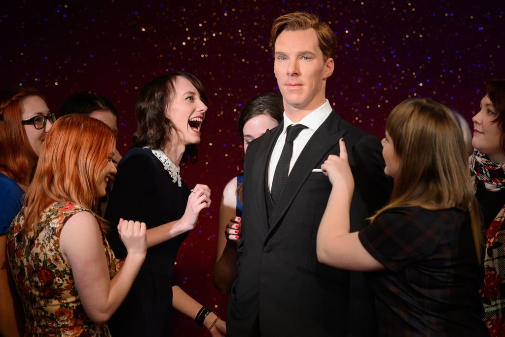 Benedict Cumberbatch's long-awaited wax figure is finally here, and it's already sending fangirls in London into a tizzy. On Monday, a group of women was given the chance to be the first fans to see Benedict's new statue at Madame Tussauds in England, and they reacted as any proud Cumberbitch would — be it stroking, inspecting, jumping for joy, and taking as many selfies as humanly possible. It's probably best the man himself didn't show up to the unveiling, since we already know that his mere presence can cause his hard-core female fans to go nuts.