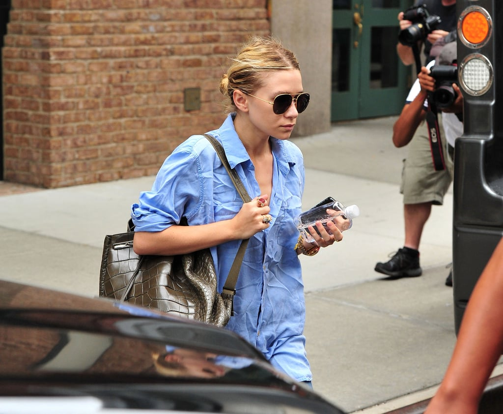 Ashley wore a pair with a blue button-down and an olive animal-textured backpack in NYC in 2011.