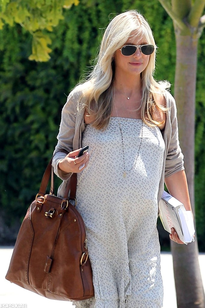 "Sarah Michelle Gellar showed off her baby bump and a new, blonder 'do while leaving Andy LeCompte Salon in LA yesterday. Sarah Michelle held on to her Yves Saint Laurent Muse bag as well as a copy of the courtroom drama Defending Jacob as she made her way down the street. Nicole Richie was also spotted heading out of the popular Hollywood hair salon. Sarah Michelle is currently pregnant with a baby boy, who is reportedly due later this year. Her CW series Ringer is no more, but network president Mark Pedowitz told press at the TCA that he wants her back ""either as an actress or producer"" after she gives birth."