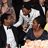Pharrell Williams stopped to chat with Denzel Washington and his wife, Pauletta.