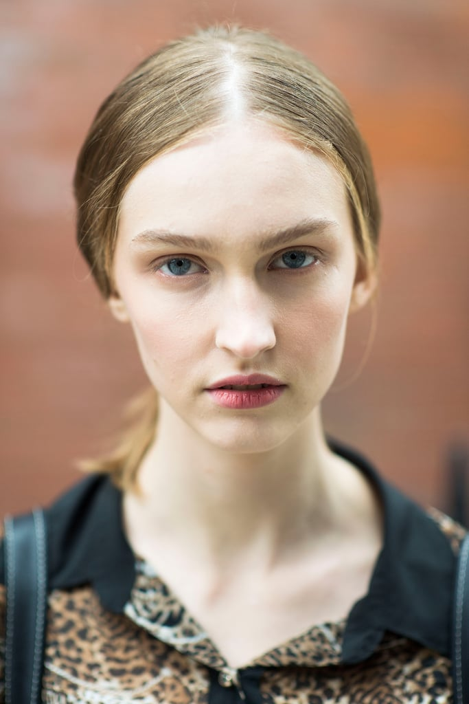 With a middle-parted ponytail and dusty rose lips, this girl looks like she just stepped out of a vintage photograph.  Source: Le 21ème | Adam Katz Sinding