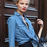 A great red lip, chambray button-down and classic black dress all come into play in this attention-getting look. Source: Greg Kessler