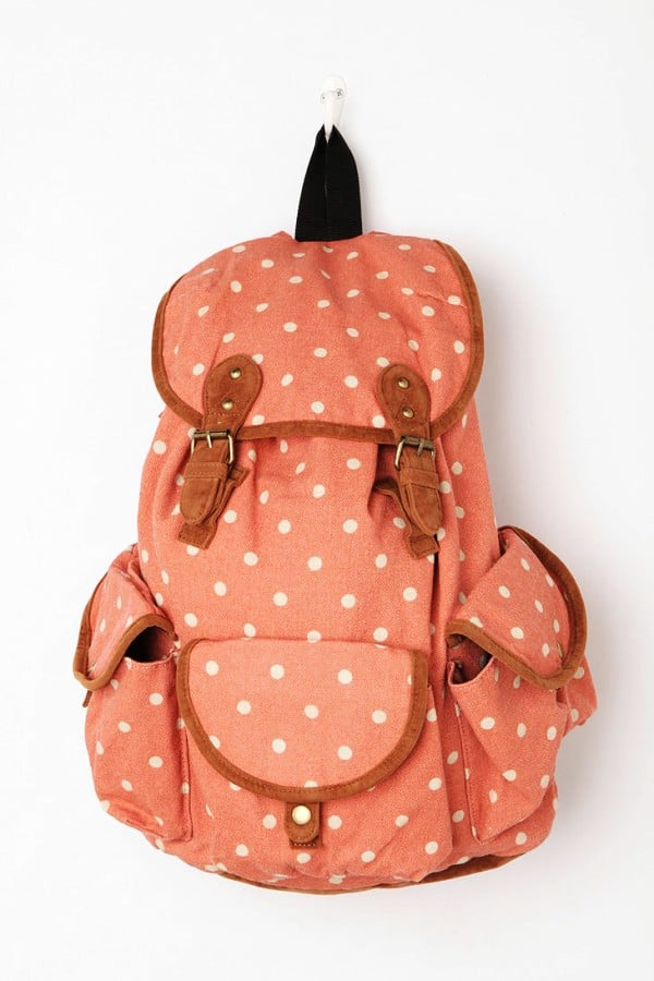 For a sweet but grown-up look, don this polka-dot Carrot tri-pocket backpack ($69).
