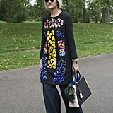 Wear an embellished tunic over wide-leg jeans that pool to the ground.