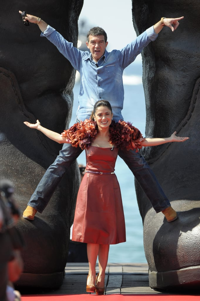 Salma Hayek and Antonio Banderas were in a playful mood today at the Cannes Film Festival during a photocall for Puss in Boots. Salma wore a dramatic, leather Gucci dress with flowers around the shoulders in the spirit of Jennifer Lopez's Met Gala gown to the event, which was held along the water at Carlton Beach. The actress, who just launched her makeup line Nuance by Salma Hayek in NYC last week, showed off her fun chemistry with Antonio as they posed on the red carpet and on a giant pair of boots. They're just a few of the international stars who have made their way to France for the prestigious cinema fest. Johnny Depp and Penelope Cruz will be there for a special premiere of Pirates of the Caribbean: On Stranger Tides, Angelina Jolie will attend for Kung Fu Panda 2, and Brad Pitt will debut the Terrence Malick-directed The Tree of Life. We'll be in the French Riviera for all the action, so stay tuned for all our coverage in the coming days!