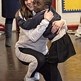 Kate gave a big hug to a little girl at the Bond Primary School in January 2018.