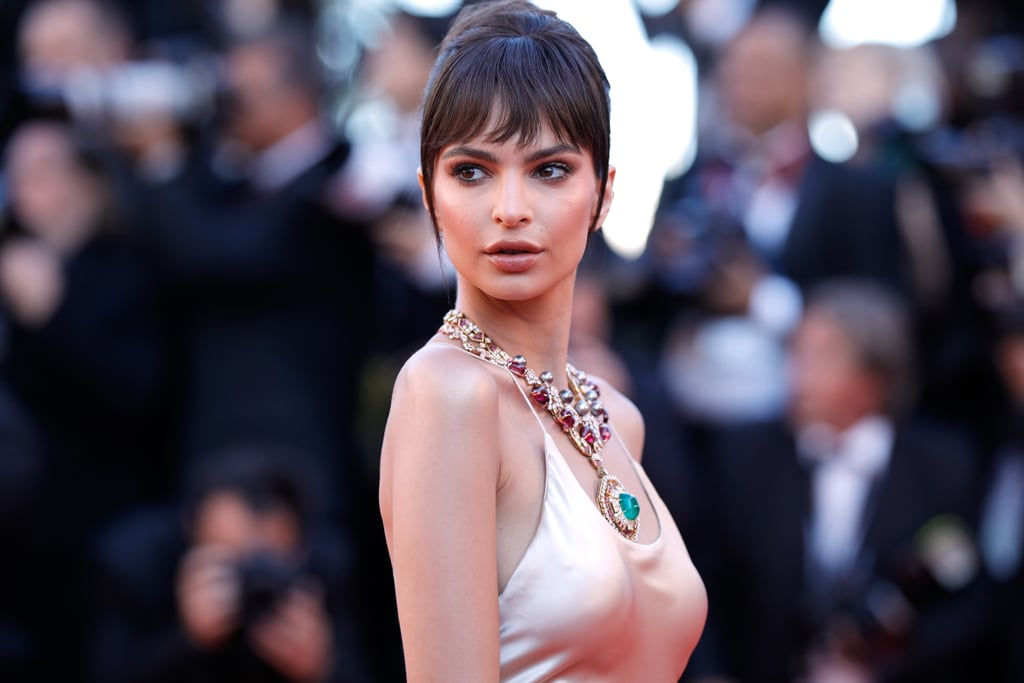 Emily Ratajkowski is in the South of France for her very first Cannes Film Festival, and from the moment she touched down at the airport on Tuesday, she's been totally crushing it. After arriving on the Croisette, Emily slipped into a bikini and boarded a yacht (like any self-respecting bombshell would do). She shared photos of herself in a red two-piece on Wednesday, then did a quick costume change for an afternoon by the pool at the infamous Hotel du Cap-Eden-Roc; the 25-year-old model turned heads in a sea-green bikini that she wore under a pretty printed dress.    Emily was all smiles while posing for photos on the hotel balcony with film producer Mohammed Al Turki. Naturally, she gave fans a glimpse of her red carpet jewellery with a topless Instagram photo, then hit the red carpet in all her glory for the opening gala and premiere of Ismael's Ghosts. All in a day's work, right? Keep reading to see snaps from her week so far.      Related:                                                                                                           15 Times Emily Ratajkowski Made a Salient Point About Sexuality